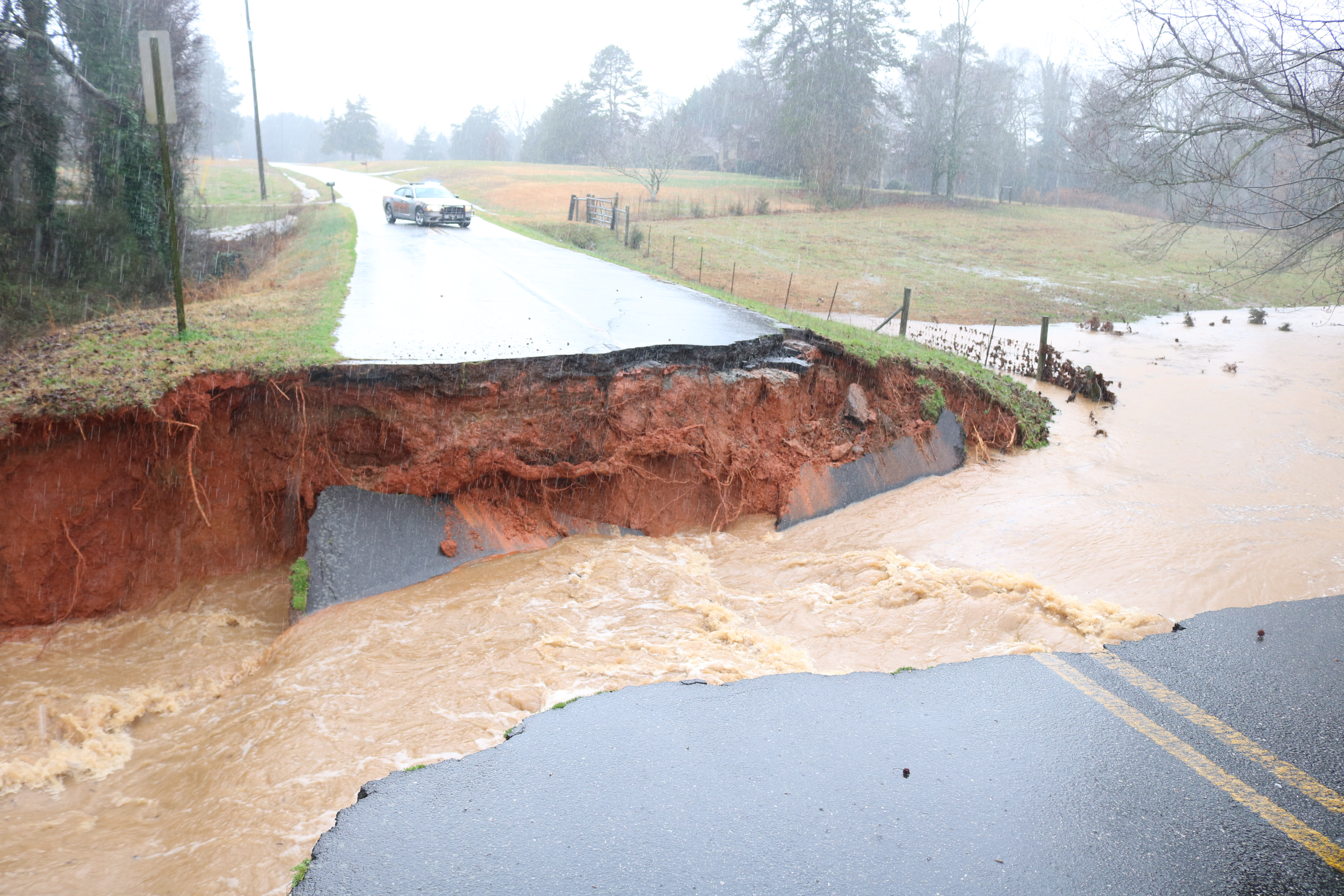 Sunshot by Grayson Williams - A flash flood created a temporary raging river and washed out Deer Run Lane on Thursday, Feb. 6, when torrential downpours caused flooding around Hart County.