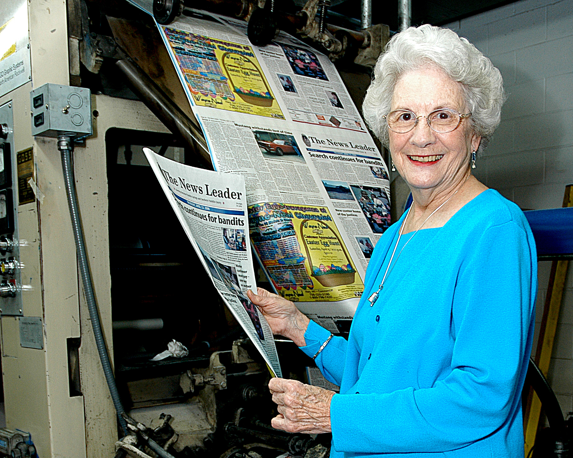 Sunshot from file by Bill Powell — Wassie Vickery holds a newspaper fresh off the press at The Hartwell Sun in 2006.
