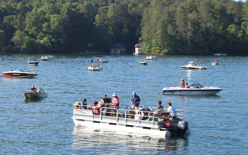 Boats gather on Lake Rabun for boat church, a service of Clayton First United Methodist Church. PHOTO/MEGAN BROOME
