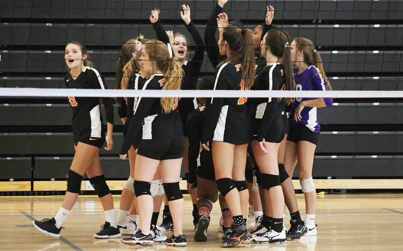 Sunshots by Grayson Williams — The Hart County Volleydogs celebrate a point during a match last week at Hart County High School.