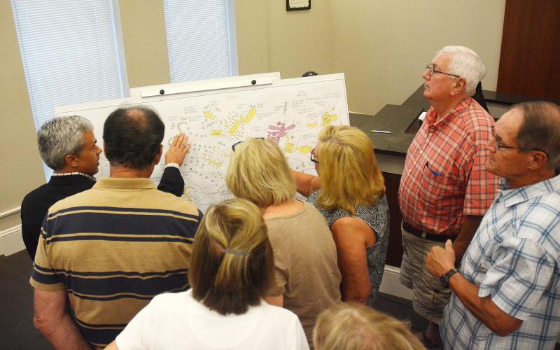 Sunshot by Michael Hall — A group of audience members gather during an executive session at the Sept. 9 Hartwell City Council meeting to learn details from consultant Shawn Davis, far left, of the proposed project to rethink Hart State Park.