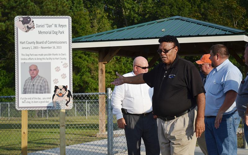 Sunshot by Michael Hall — Hart County Commissioner R.C. Oglesby talks during the dedication ceremony on Sept. 5 naming the dog park at the Hart County recreation complex after the late commissioner Dan Reyen.