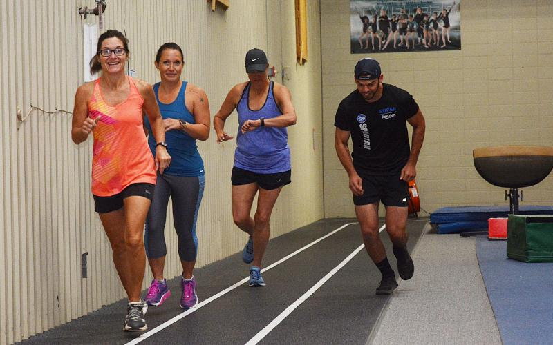 Sunshot by Michael Hall -- Julie George, left, Julie Boleman, second from left, Kay Ankerich, second from right a Andrew Wilder, right, start the first heat of the Honor the Heroes Fitness Challenge on Labor Day at the Bell Family YMCA.