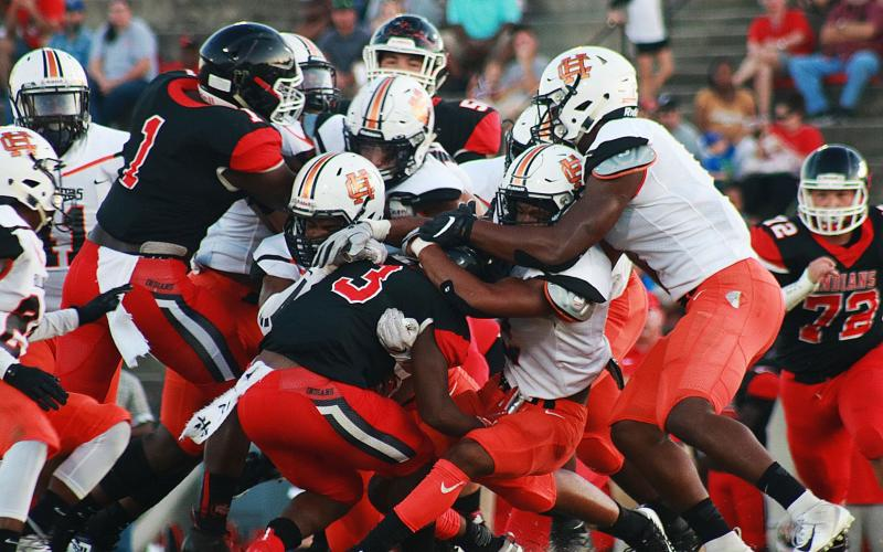 Sunshots by Grayson Williams -- Hart County's defense swarms a Stephens County ball carrier on Aug. 30 in Toccoa. The Bulldogs went on to win 26-13.