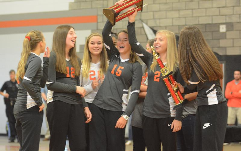 Sunshot by Michael Hall — Brooklyn Hubbard, Ryann Williamson, Abby Hubbard, Ella Franklin, Hannah Harris and Lillie Kate Rogers show off their North Georgia State Championship trophy at a pep rally on Oct. 7 at Hart County Middle School.