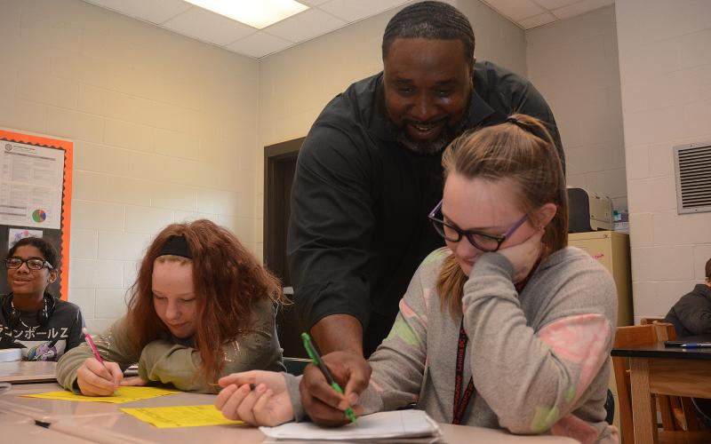 Sunshot by Michael Hall — Middle school teacher Earl Fouch helps students during a math exercise at Hart County Middle School on Monday, Nov. 4.
