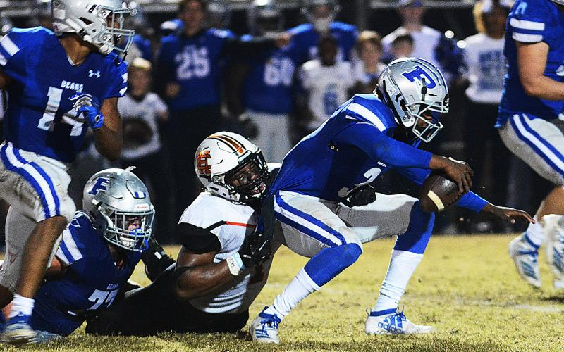 Hart County's Kaimon Rucker pulls down the Pierce County quarterback for a sack late in the game in Blackshear on Nov. 22 in the second round of the state playoffs.