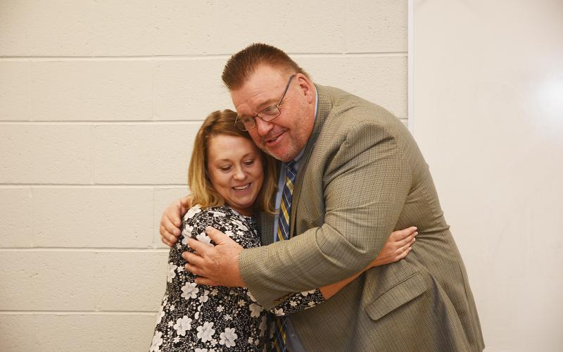 Sunshot by Michael Hall — Hart County Teacher of the Year Christie Simpson, left, hugs Superintendent Jay Floyd on Nov. 15 at the Hart College and Career Academy's community room after she was announced as the system-wide winner of the award.