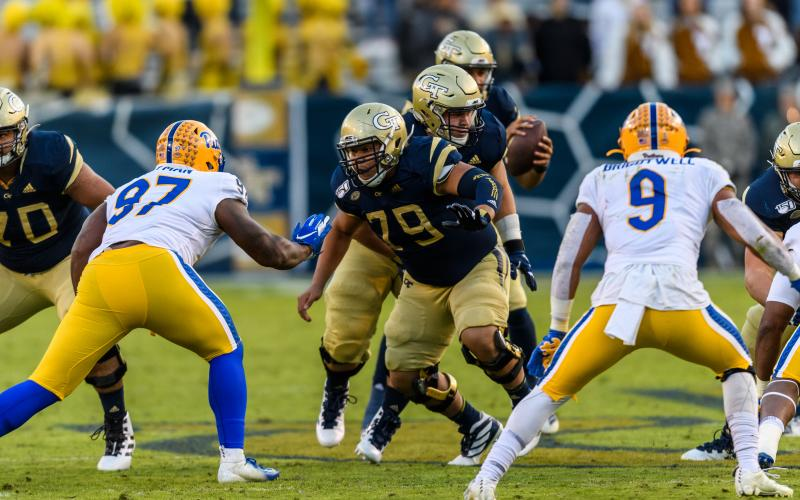 Photos by Danny Karnik/Georgia Tech - Georgia Tech center William Lay, center, a Hart County graduate, blocks on the offensive line during a game this season against Pittsburgh.