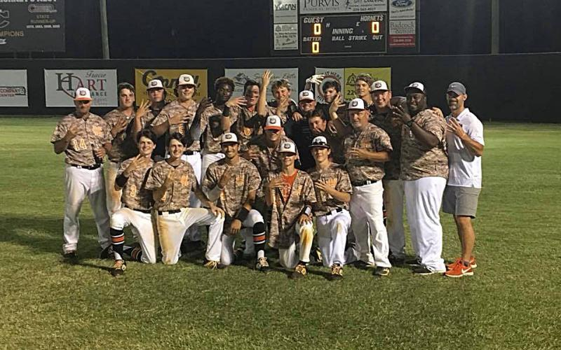Sunshot from file — Hart County's baseball team poses for a photo holding up fours with their hands after punching their ticket to the Final Four of the state playoffs in May.