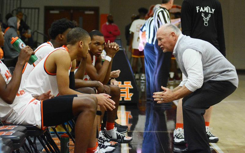 Sunshot by Michael Hall — Hart County head boys' basketball coach Harry Marsh talks to his team prior to tip-off against Abbeville at home on Saturday in which the Bulldogs won 68-57, marking Marsh's 650th win as a boys' team head coach.