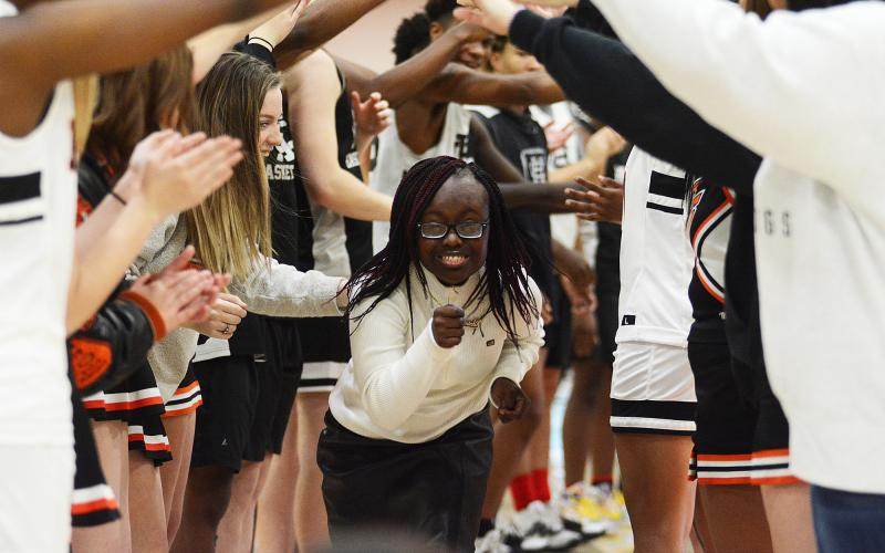 Sunshots by Grayson Williams — Briamah Edmond runs under an arch of hands made by basketball players and cheerleaders at Buddy Basketball on Dec. 16 at Hart County High School.