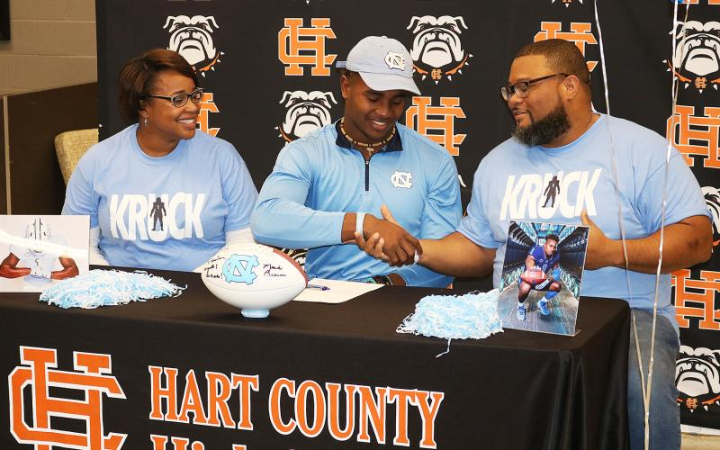 Sunshot from filem — 5. Hart County's Kaimon Rucker signs his National Letter of Intent to play football at the University of North Carolina on Dec. 18. Rucker was among several athletes from all sports to get attention from college recruiters in 2019.