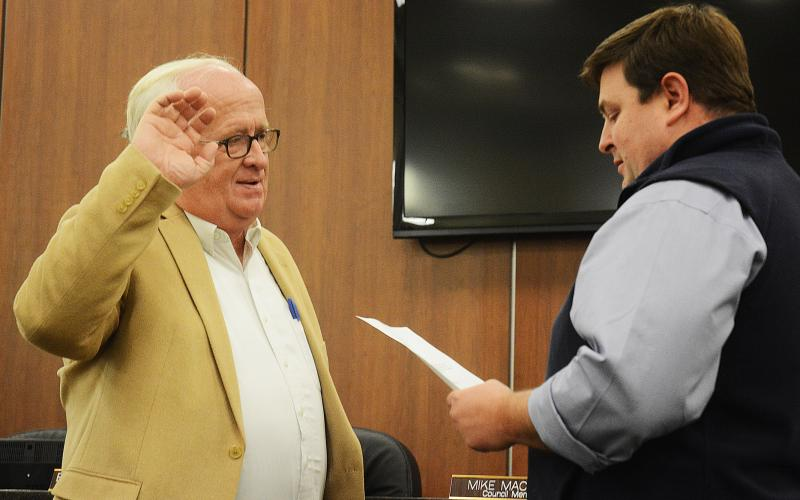 "Sunshot by Michael Hall - New Hartwell city councilman Stephen ""Doc"" Ayers, takes his oath of office, administered by city manager Jon Herschell, at the first city council meeting of the year on Jan. 6."