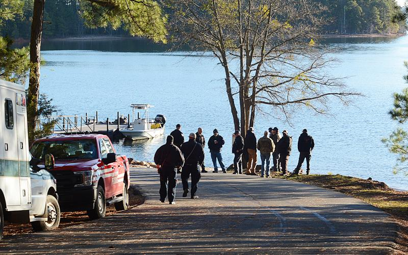 Law enforcement, DNR and fire department personnel gather at the Carter's Ferry Boat Ramp in the Reed Creek community Thursday to continue the search that began Wednesday for a missing boater.