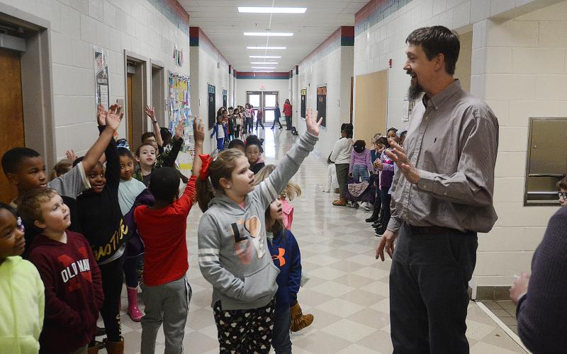 Sunshot by Michael Hall - Mark Seabolt, general manager of Dairy Queen in Hartwell, talks with first graders at Hartwell Elementary recently.