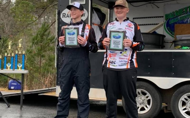 Photo submitted - Dallas Hancock, left, and Xander Patton, show off their first-place plaques for winning the PBC tournament on Lake Russell.