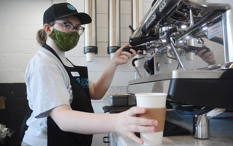 Sunshot by Michael Hall — Barrista Sadie Cornett makes an espresso drink at Common Ground in Hartwell on Tuesday, June 2.