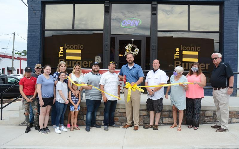 Sunshot by Michael Hall — Pictured are Mariah Hobbs, from left to right, Brady Dobson, Breanna Stansell, Angie Hickey, Madison Fleeman, Leah Carey and Trinity Carey, Joshua Sellers, David Sellers, Mayor Brandon Johnson, Hartwell city councilman Tray Hicks, Marylynn Johnson and Melissa Weatherbee, both with Hartwell Main Street, and Hartwell city councilman Doc Ayers.