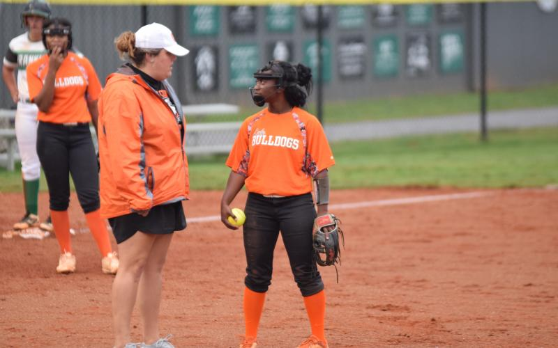 "Photo by Shane Scoggins/Franklin Co. Citizen-Leader Coach Katie Jo Gentry talks to pitcher Taikibrea ""Red"" Campbell during the Bulldogs' win over Franklin County in Carnesville on Sept. 24."