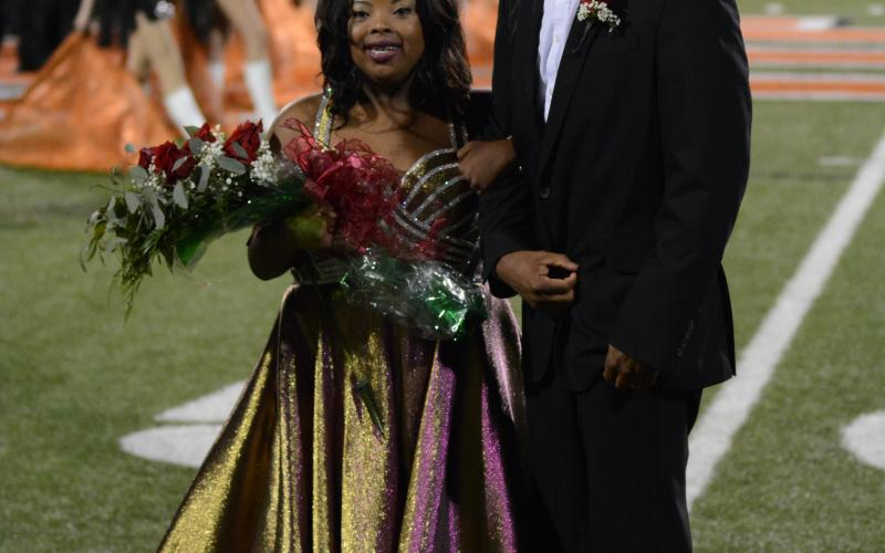 Taylor Freeman, left, smiles with her father and escort, Tyler Freeman, after being crowned the 2020 Homecoming Queen for Hart County High School on Friday, Oct. 16, at Herndon Stadium.