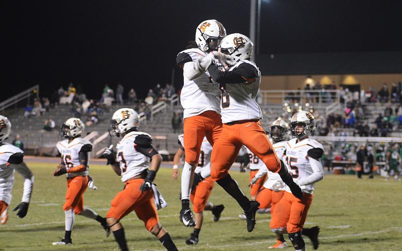 Players celebrate a big play in the 2019 win by the Bulldogs over the Franklin County Lions. The two teams will meet for this year's game on Friday, Oct. 16.