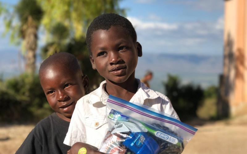 Photo submitted - Children in Haiti smile with their Joybags given to them by Love Him Love Them ministries during a trip to Haiti last holiday season.