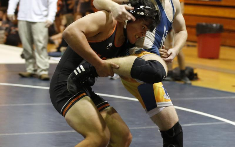 Photo by Rose Scoggins - Logan Lopez tries to take down his opponent Tuesday, Dec. 1 in Elbert County.