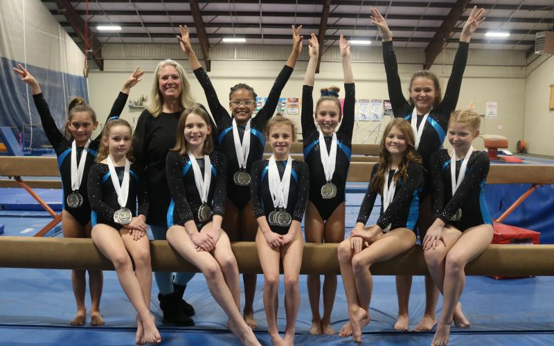 Sunshot by Grayson Williams - The Hartwell Twisters are pictured with medals from a recent competition. Pictured from left to right, back row, Maci Dudley, coach Shellye Ayers, Cheyenne Rucker, Madalyn Dault, Kailyn Bowers, front row, Aeryn Back, Adrianna Pennington, Tinsley Starrett, Bella Beck and Chastyn Haynie.