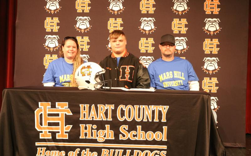 Sunshot by Grayson Williams Gabriel Coker, center, flanked by his mom, Amanda Morgan, and dad, Lee Morgan, signed last week to play college football at Mars Hill University.