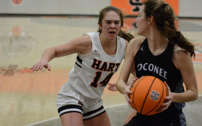 Sunshot by Grayson Williams - Dakota Phillips goes for the ball against an Oconee County player on Monday, Feb. 15, at Hart County High School.