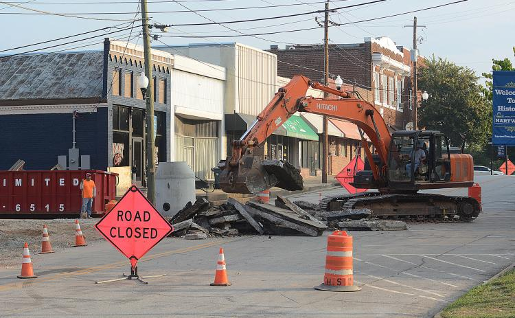 Sunshot by Michael Hall — Heavy machinery breaks up the asphalt at the corner of Forest Avenue and Depot Street on Tuesday as work continues on a major infrastructure improvement project underneath Depot Street.