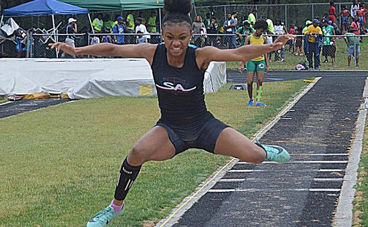 Valasha Carter competes in the triple jump at a recent event.