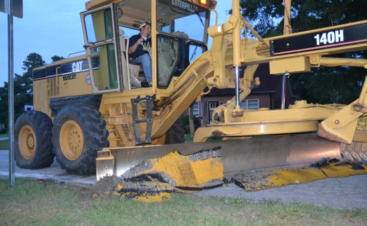 Sunshot by Michael Isom — A crew from the Hart County Road Department was immediately called to take down four speed bumps on East Main Street Tuesday night as soon as a vote passed from the town council to concede to county officials' and various residents' concerns.