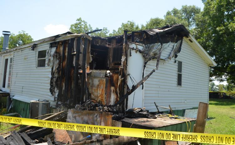 Authoritie have taken out arrest warrants for a Vanna man they claim intentionally set fire to this home on Joe Findley Road.