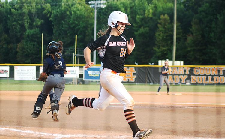 Sunshot by Grayson Williams — Anslee Mitchell scores a run against East Jackson last week at Hart County High School.