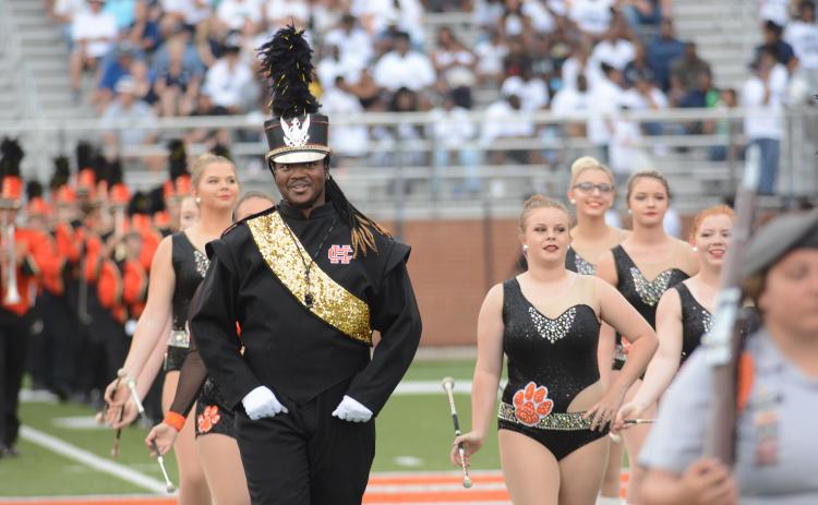 File photo — Drum Major Rendarris Gaines leads the Bulldog Band on the field this season.