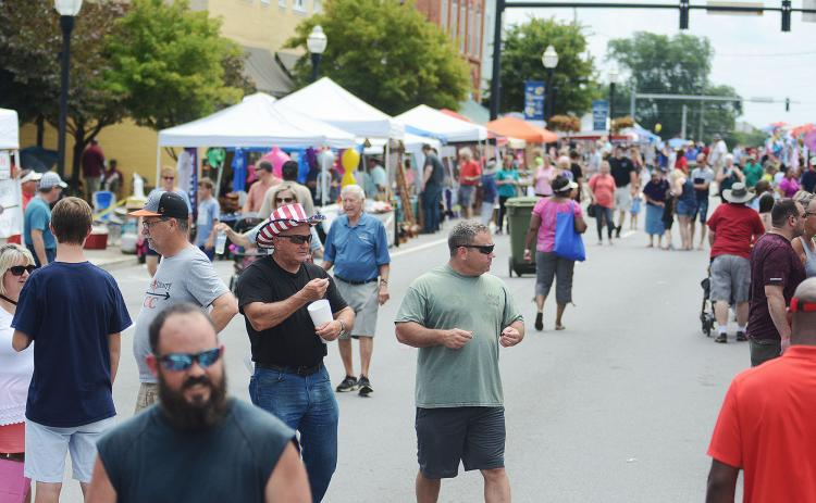 Sunshot from file - The crowd at the Pre-Fourth celebration in downtown Hartwell enjoys the festival last June. The Hartwell Main Street Program has been named the Main Street Program of the Month for January 2020.
