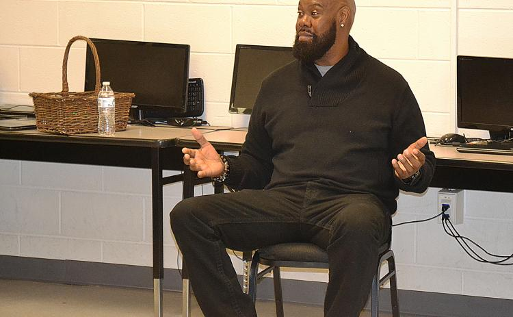 Sunshot by Drew Dotson - Former NFL offensive lineman and Royston native Tony Jones talks to students at the Hart County Alternative Program on Wednesday, Dec. 6.