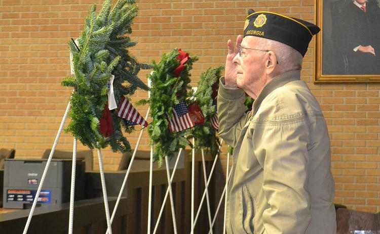 "Sunshot from file — World War II Army veteran Harold ""Andy"" Anderson salutes during the presentation of the Wreaths Across America in December 2018 at the Hart County Courthouse."