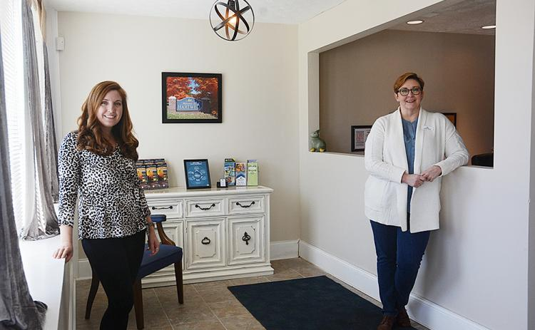 Hart County Chamber of Commerce director Christine Blomberg and Tiffany Rucker stand in the lobby of the chamber offices on Carolina Street.