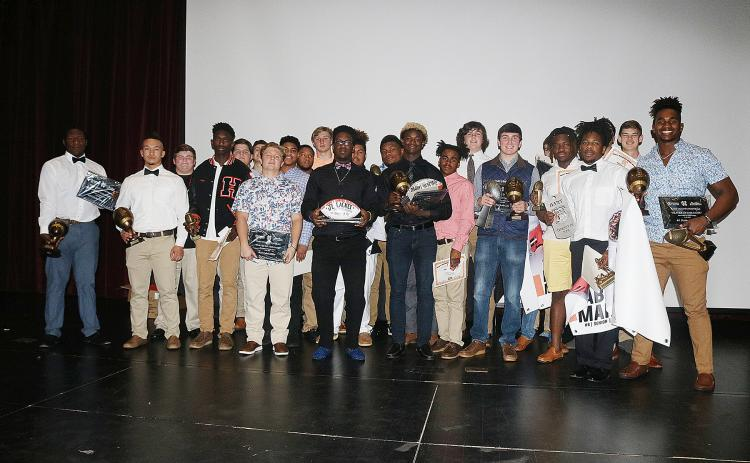 Sunshot by Grayson Williams - Hart County Football award winners show off their awards after the Hart County Football banquet on Jan. 16.Sunshot by Grayson Williams Hart County Football award winners show off their awards after the Hart County Football banquet on Jan. 16.
