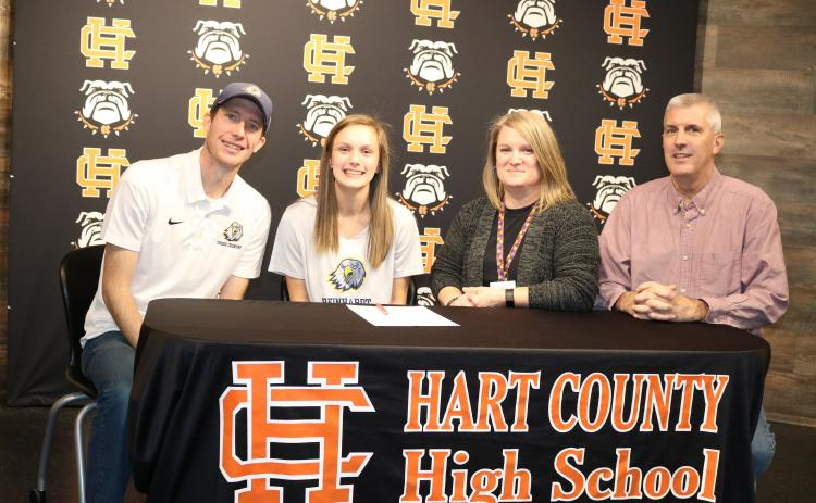 Sunshot by Grayson Williams Jillian Hoell second from left, signed on Jan. 31 to run cross country at Reinhardt University next season. Pictured are Reinhardt coach Jordan Turner, Hoell, her mother Sarah Hoell and father Roy Hoell.