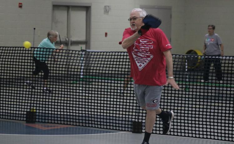 Sunshots by Grayson Williams - Paul Martin, above, volleys during a pickleball game at the Bell Family YMCA in Hartwell on Tuesday.