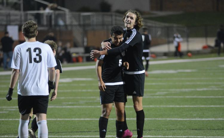 Sunshot by Grayson Williams Renso Escobedo, left, celebrates with Lincoln Zemaitis following Escobedo's goal against Oglethorpe County at Hart County High School on Feb. 25.