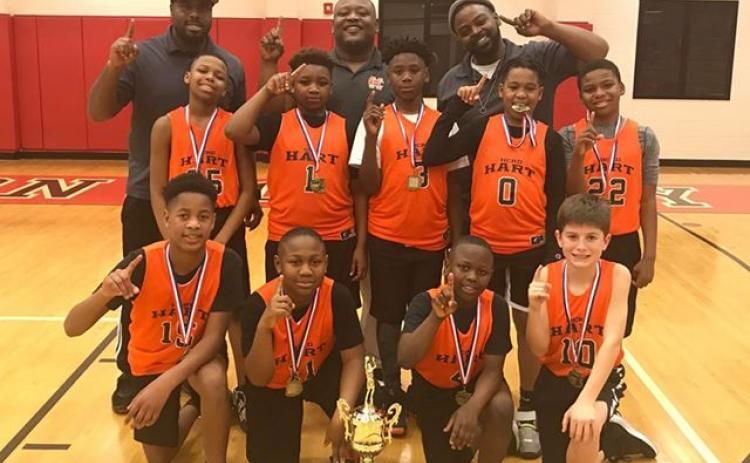 Pictured is the Hart County GRPA 10U Youth Basketball District 7 Championship team. Pictured from left to right are, bottom row, Xavier Cade,  Boss Blackwell, Kamren Brewer, Crew Franklin, middle row, Isaiah Porter-Allen, Bryshun Jordan, Cincere Roebuck, Kurston Curry, Marquez Goss, back row, coaches Kurvin Curry, Phil Blackwell and Ron Allen.