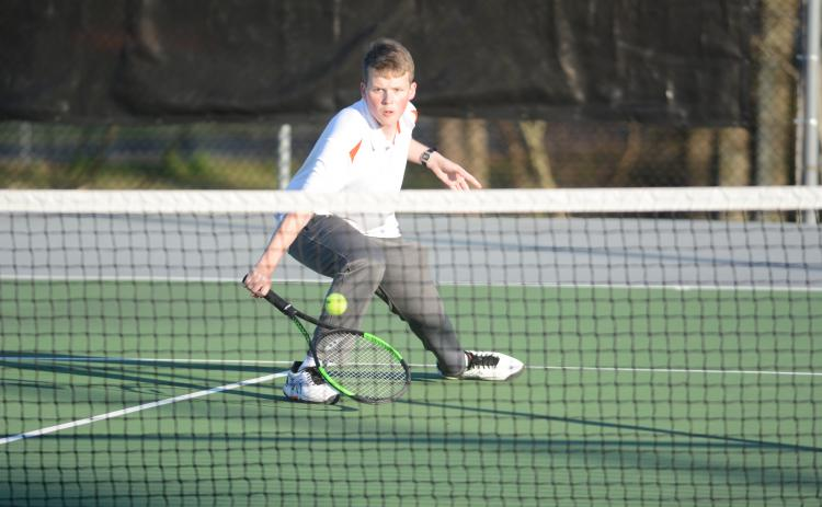 Sunshot by Grayson Williams - Hart County's No. 2 singles player, Michael Floyd, returns a volley on March 6 at Hart County High School.
