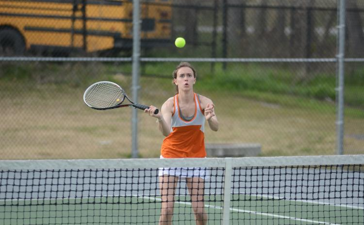 Sunshot by Grayson Williams - Sydney Smith returns a volley at Hart County High School on March 12.