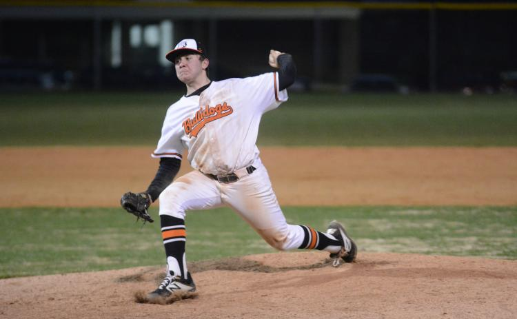 Sunshot by Grayson Williams - Hart County pitcher J.P. White deals from the mound Friday at Saye Field where the Bulldogs rallied to beat Stephens County 7-4.