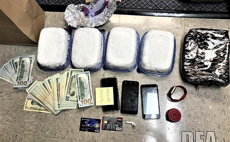 Drugs, money and other items confiscated as part of a two-year federal, state and local drug investigation are shown.